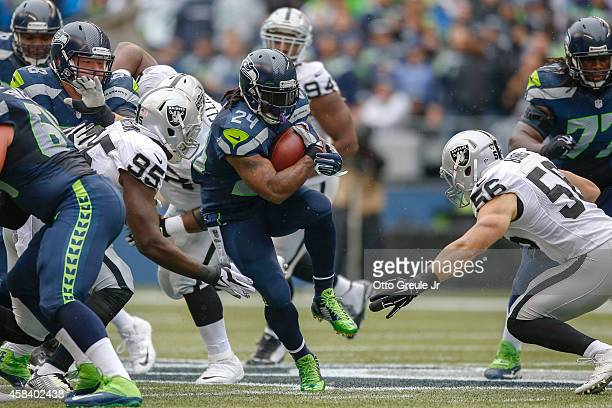 Running back Marshawn Lynch of the Seattle Seahawks rushes against the Oakland Raiders at CenturyLink Field on November 2 2014 in Seattle Washington