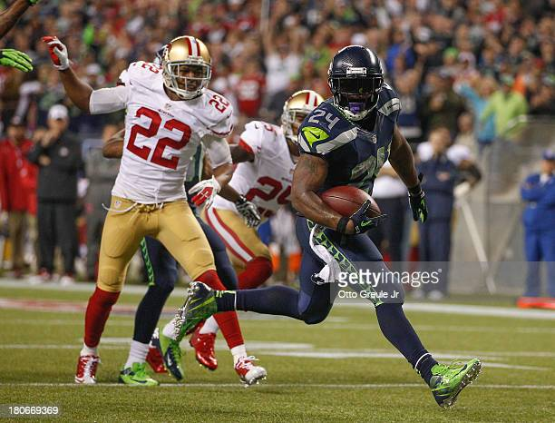 Running back Marshawn Lynch of the Seattle Seahawks rushes for a touchdown in the third quarter against the San Francisco 49ers at CenturyLink Field...