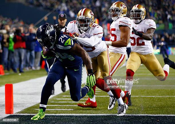 Running back Marshawn Lynch of the Seattle Seahawks scores a 40yard touchdown against cornerback Tarell Brown of the San Francisco 49ers in the third...