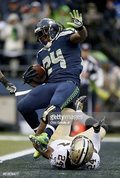 Running back Marshawn Lynch of the Seattle Seahawks scores a touchdown on a 15-yard run in the second quarter against cornerback Corey White of the...