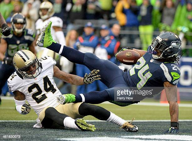 Running back Marshawn Lynch of the Seattle Seahawks scores a touchdown on a 15yard run in the second quarter against cornerback Corey White of the...