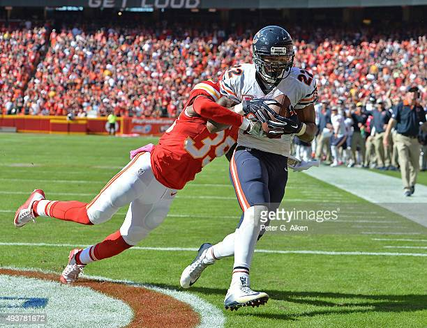 Running back Mat Forte of the Chicago Bears catches the game winning touchdown pass against safety Husain Abdullah of the Kansas City Chiefs during...