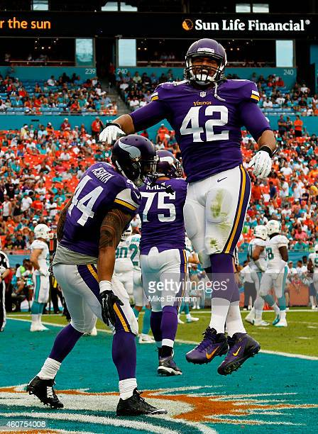 Running back Matt Asiata of the Minnesota Vikings celebrates with fullback Jerome Felton in the end zone after Asiata scored a fourth quarter...