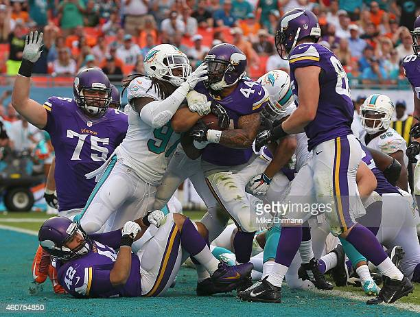 Running back Matt Asiata of the Minnesota Vikings runs in the end zone as he scored a fourth quarter touchdown as middle linebacker Kelvin Sheppard...