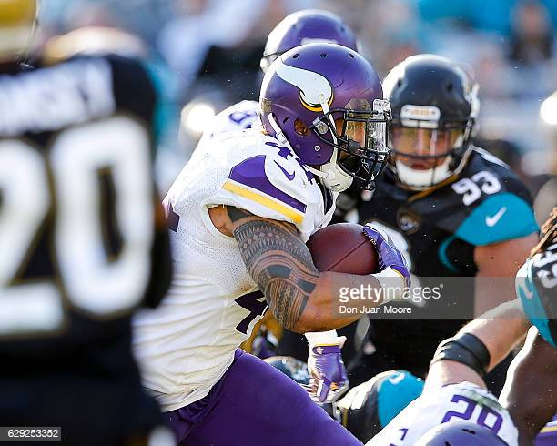 Running back Matt Asiata of the Minnesota Vikings runs through the middle of the field during the game against the Jacksonville Jaguars at EverBank...