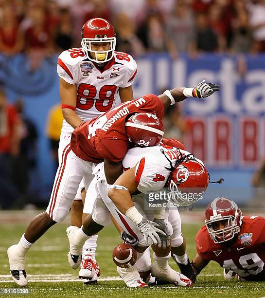 Running back Matt Asiata of the Utah Utes fumbles the football as he is hit by defensive back Marquis Johnson of the Alabama Crimson Tide during the...