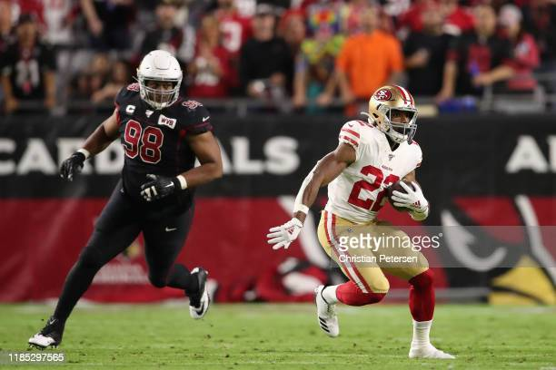 Running back Matt Breida of the San Francisco 49ers rushes the football past defensive tackle Corey Peters of the Arizona Cardinals during the first...
