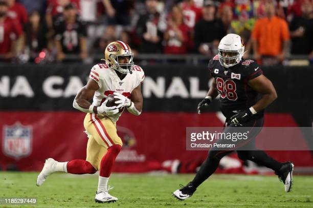 Running back Matt Breida of the San Francisco 49ers rushes the football against defensive tackle Corey Peters of the Arizona Cardinals during the...