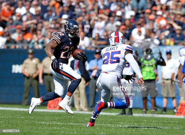 Running back Matt Forte of the Chicago Bears carries the ball during the fourth quarter as strong safety Da'Norris Searcy of the Buffalo Bills...