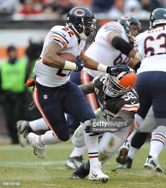 Running back Matt Forte of the Chicago Bears is tackled by linebacker D'Qwell Jackson of the Cleveland Browns during a game against the Cleveland...