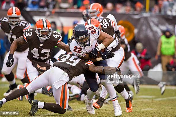 Running back Matt Forte of the Chicago Bears runs for a gain while under pressure from free safety Tashaun Gipson strong safety TJ Ward and defensive...