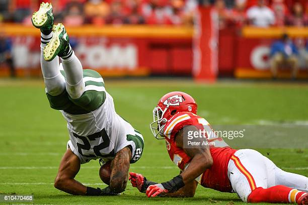 Running back Matt Forte of the New York Jets is up ended by inside linebacker Derrick Johnson of the Kansas City Chiefs at Arrowhead Stadium during...