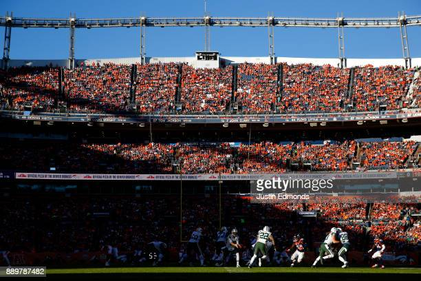 Running back Matt Forte of the New York Jets receives a pitch during the second quarter against the Denver Broncos at Sports Authority Field at Mile...