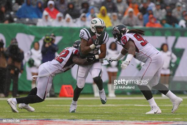 Running back Matt Forte of the New York Jets runs the ball against strong safety Keanu Neal and defensive end Adrian Clayborn of the Atlanta Falcons...