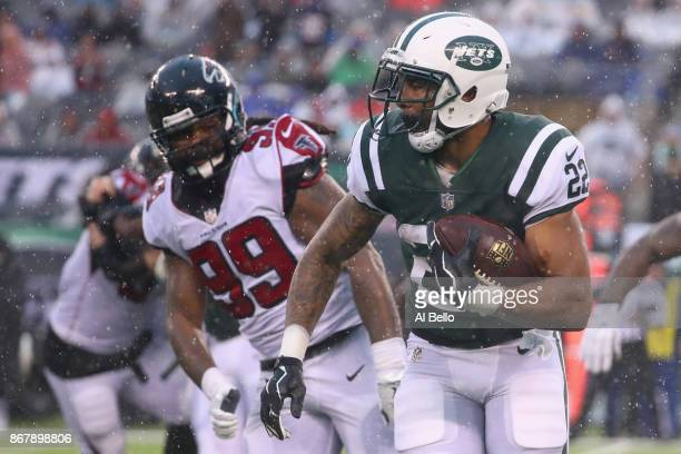 Running back Matt Forte of the New York Jets runs the ball against defensive end Adrian Clayborn of the Atlanta Falcons during the fourth quarter of...