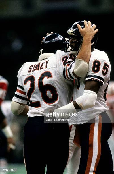 Running Back Matt Suhey and Dennis McKinnon of the Chicago Bears celebrate after a score in Super Bowl XX against the New England Patriots at the...
