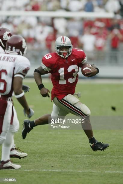 Running Back Maurice Clarett of Ohio State rushes against Washington State in the fourth quarter on September 14 2002 at Ohio Stadium in Columbus...