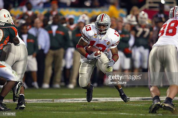Running back Maurice Clarett of the Ohio State Buckeyes finds a hole against the University of Miami Hurricanes during the Tostitos Fiesta Bowl at...