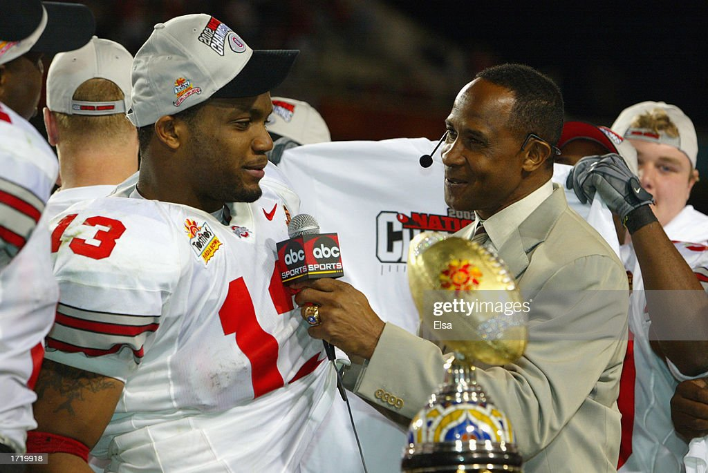 Running back Maurice Clarett #13 of the Ohio State Buckeyes is interviewed by Lynn Swann after deafeating the Miami Hurricanes in the Tostitos Fiesta Bowl on January 3, 2003 at Sun Devil Stadium in Tempe, Arizona. Ohio State won the game 31-24 in double-overtime, winning the NCAA National Championship.