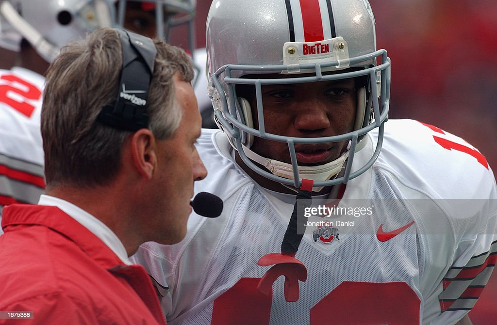 Running back Maurice Clarett #13 of the Ohio State Buckeyes listens to head coach Jim Tressel during the Big Ten Conference football game against the Wisconsin Badgers at Camp Randall Stadium on October 19, 2002 in Madison, Wisconsin. The Buckeyes won 19-14.