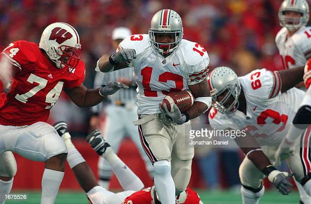 Running back Maurice Clarett of the Ohio State Buckeyes runs with the ball during the Big Ten Conference football game against the Wisconsin Badgers...