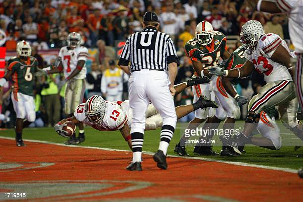 Running back Maurice Clarett of the Ohio State Buckeyes scores the team's game winning touchdown in doubleovertime against the University of Miami...