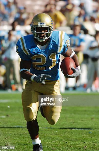 Running back Maurice Drew of the UCLA Bruins runs upfield against the Stanford Cardinal at the Rose Bowl on October 30 2004 in Pasadena California...