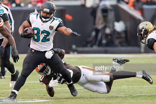 Running back Maurice Jones-Drew of the Jacksonville Jaguars avoids a tackle from outside linebacker Tank Carder of the Cleveland Browns during the...