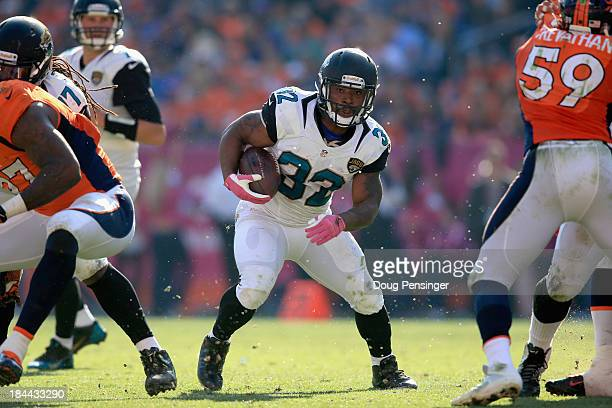 Running back Maurice Jones-Drew of the Jacksonville Jaguars carries the ball against the Denver Broncos at Sports Authority Field at Mile High on...