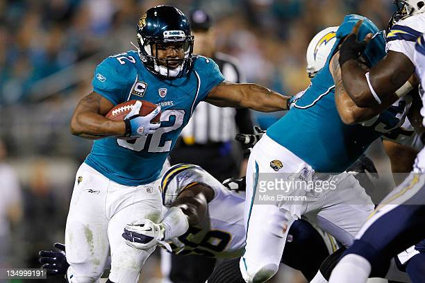 Running back Maurice JonesDrew of the Jacksonville Jaguars rushes with the ball against the San Diego Chargers at EverBank Field on December 5 2011...