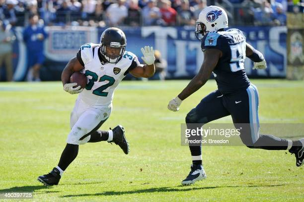 Running back Maurice Jones-Drew of the Jacksonville Jaguars rushes against Akeem Ayers of the Tennessee Titans at LP Field on November 10, 2013 in...