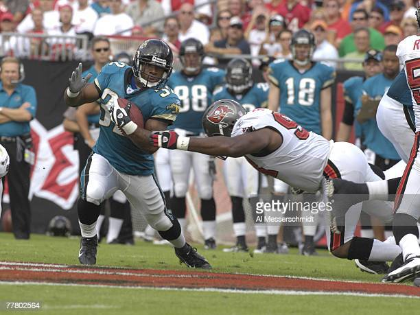 Running back Maurice JonesDrew of the Jacksonville Jaguars rushes upfield against the Tampa Bay Buccaneers at Raymond James Stadium on October 28...