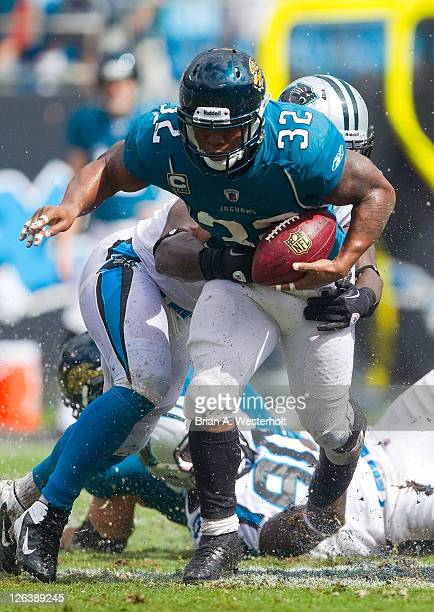 Running back Maurice JonesDrew of the Jacksonville Jaguars tries to escape the grasp of a Carolina Panthers defender during third quarter action at...