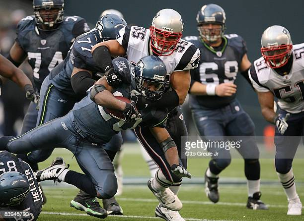 Running back Maurice Morris of the Seattle Seahawks rushes against Junior Seau of the New England Patriots on December 7, 2008 at Qwest Field in...