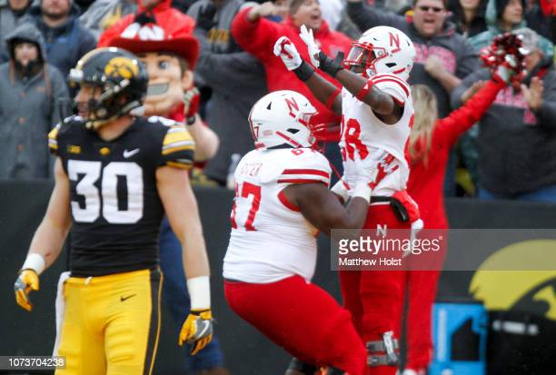Running back Maurice Washington celebrates with offensive lineman Jerald Foster of the Nebraska Cornhuskers after a touchdown in the second half...