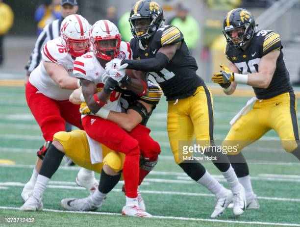 Running back Maurice Washington of the Nebraska Cornhuskers is tackled in the second half by defensive end Matt Nelson the Iowa Hawkeyes on November...