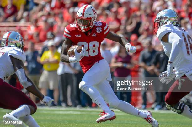 Running back Maurice Washington of the Nebraska Cornhuskers rushes against the Troy Trojans at Memorial Stadium on September 15 2018 in Lincoln...
