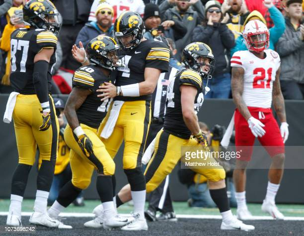 Running back Mekhi Sargent and quarterback Nate Stanley of the Iowa Hawkeyes celebrate a touchdown during the first half against the Nebraska...