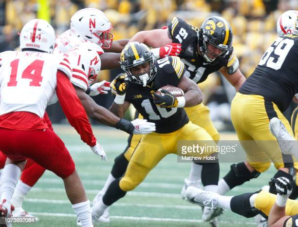 Running back Mekhi Sargent of the Iowa Hawkeyes is tackled during the first half by linebacker Mohamed Barry of the Nebraska Cornhuskers on November...
