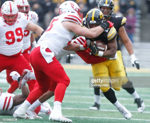 Running back Mekhi Sargent of the Iowa Hawkeyes is tackled during the first half by defensive lineman Ben Stille of the Nebraska Cornhuskers on...