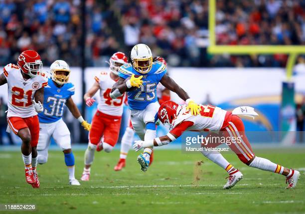 Running back Melvin Gordon of the Los Angeles Chargers carries the ball against free safety Juan Thornhill of the Kansas City Chiefs during the game...