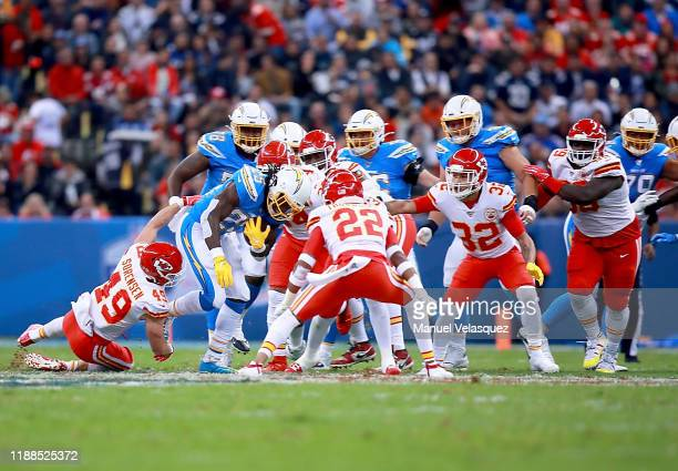 Running back Melvin Gordon of the Los Angeles Chargers carries the ball against the defense of the Kansas City Chiefs during the game at Estadio...