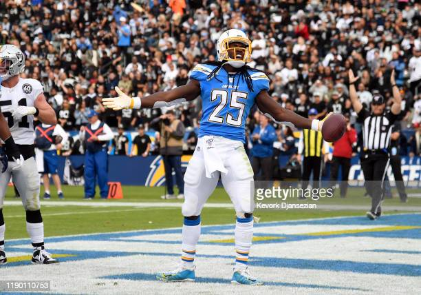 Running back Melvin Gordon of the Los Angeles Chargers celebrates after scoring a touchdown against Oakland Raiders during the first half at Dignity...