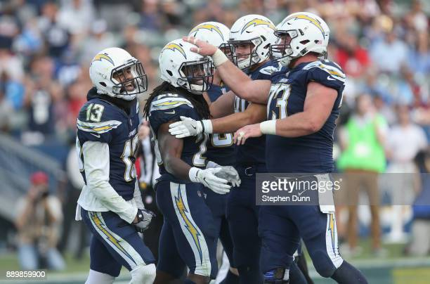 Running back Melvin Gordon of the Los Angeles Chargers celebrates with Spencer Pulley Hunter Henry and Keenan Allen after scoring on a one yard...