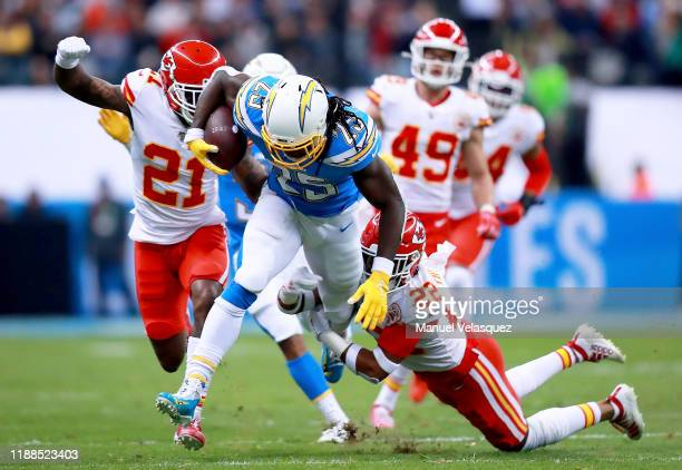 Running back Melvin Gordon of the Los Angeles Chargers is tackled by free safety Juan Thornhill of the Kansas City Chiefs during the game at Estadio...