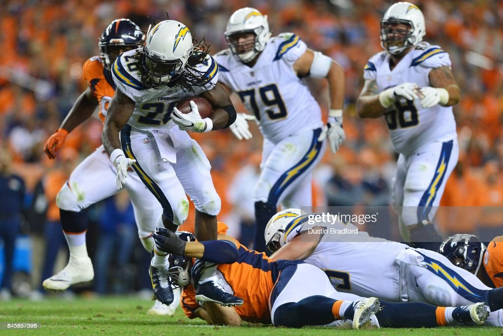 Running back Melvin Gordon #28 of the Los Angeles Chargers rushes for three yards in the second half of the game against the Denver Broncos at Sports Authority Field at Mile High on September 11, 2017 in Denver, Colorado.