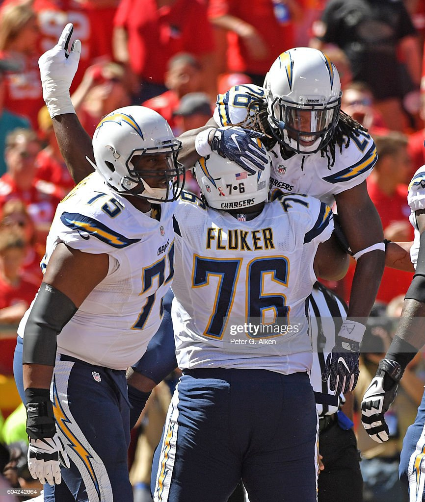 Running back Melvin Gordon #28 of the San Diego Chargers celebrates with teammates D.J. Fluker #76 and Chris Hairston #75, after scoring a touchdown against the Kansas City Chiefs during the first half on September 11, 2016 at Arrowhead Stadium in Kansas City, Missouri.