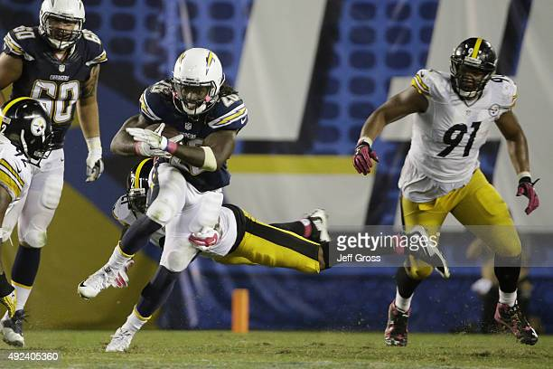 Running back Melvin Gordon of the San Diego Chargers is tackled by defensive back Ross Cockrell of the Pittsburgh Steelers at Qualcomm Stadium on...