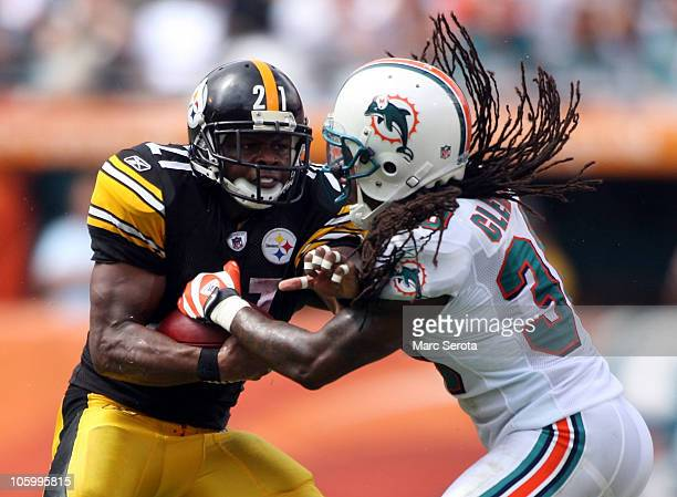 Running back Mewelde Moore is tackled by safety Chris Clemons of the Miami at Sun Life Stadium on October 24 2010 in Miami Florida