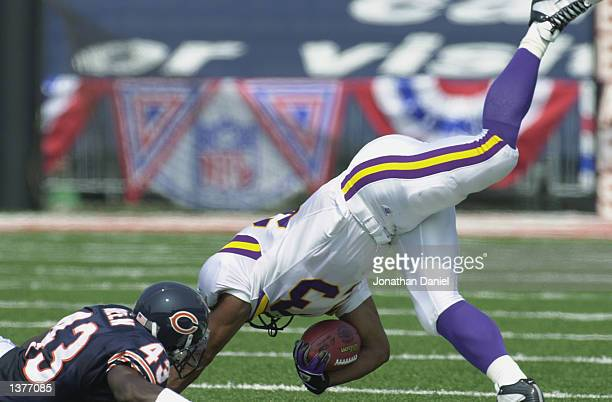 Running back Michael Bennett of the Minneosta Vikings is upended by safety Mike Brown of the Chicago Bears during their game on September 8 2002 at...